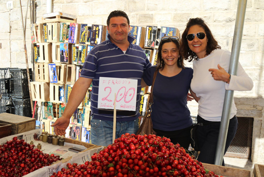 Cherry Vendor and our guide in Puglia